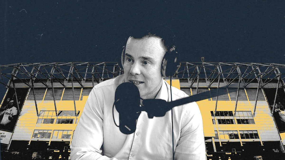 Angus Kinnear is sitting with headphones on a mic in front of his face
